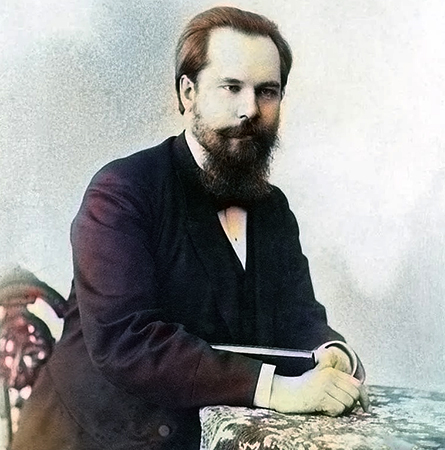 Сергей Танеев сидит за столом